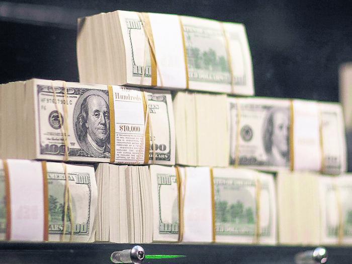 Dólar cayó con fuerza y se negoció por debajo de los $3.500
